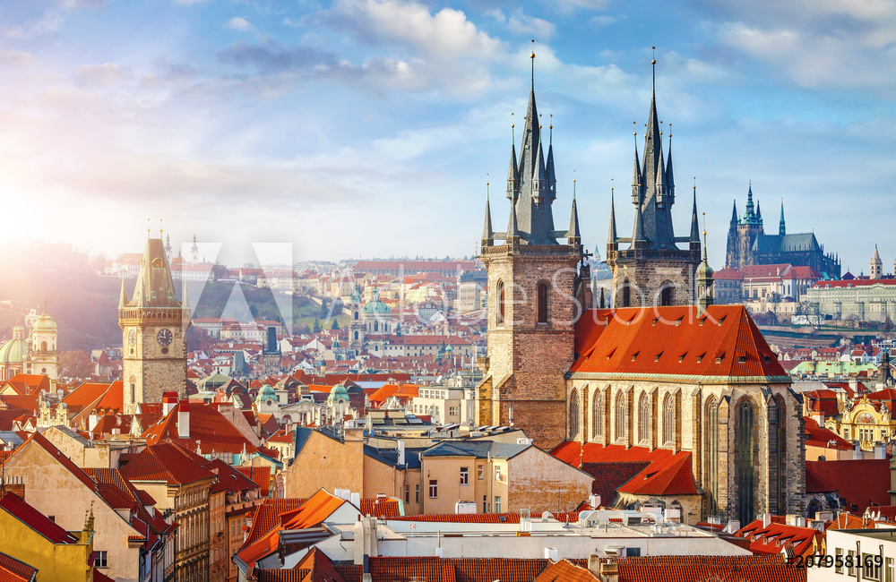 High spires towers of Tyn church in Prague city Our Lady