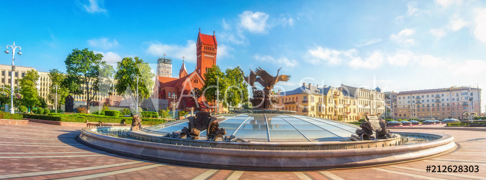 Panoramic view on Red Church or Church Of Saints Simon and Helen, Fountain at independence Square in Minsk, Belarus.