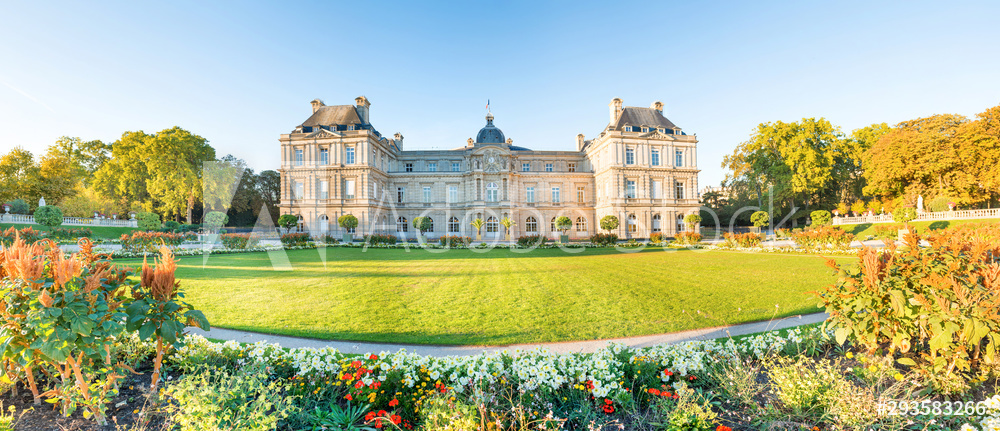 Panorama of Luxembourg garden with statues, flowers and building of Luxembourg Palace. Paris, France