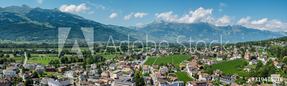 Beautiful panoramic summer view of the capital of Liechtenstein Vaduz and the Swiss Alps in the background.