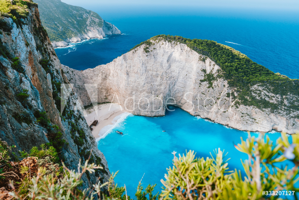 Navagio beach or Shipwreck bay. Turquoise water and pebble white beach in morning light. Famous landmark of Zakynthos island, Greece
